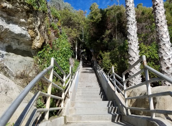 steps leading down to thousand steps beach photos in laguna beach